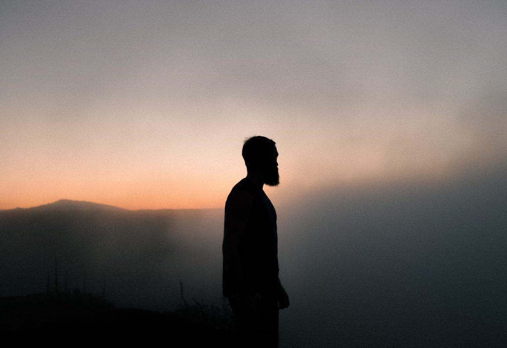 Silhouette of a man against a sunset