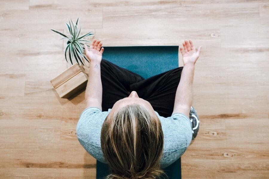 Woman on matt meditating